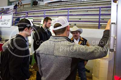 Bob Ramshaw, resident of Pomona, Kansas shows off a Travalum trailer to Kansas State University students at Cattleman's Day on March 3, 2017. (Regan Tokos | The Collegian)