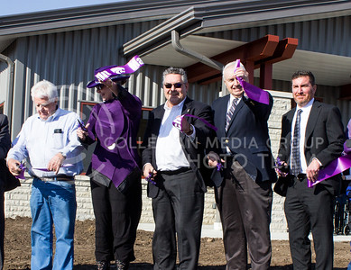 Dr. April Mason, provost and senior vice president, Dr. John Floros, dean of the college of agriculture, and Dr. Ken Odde, department head of animal sciences and industry, show off pieces of the ribbon they cut, officially dedicating the new Purebred Beef Unit on March 3, 2017. (Regan Tokos | The Collegian)