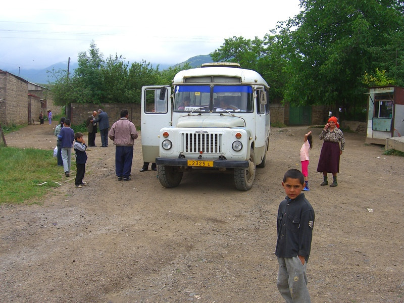 Old Bus and People in Tatev, Armenia