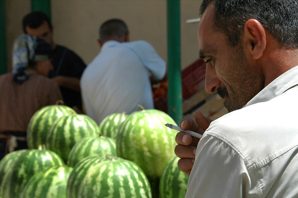 Man Looking at Melons - Baku, Azerbaijan