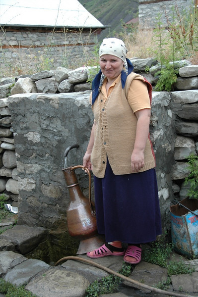 Woman Getting Water from a Spring - Lahic, Azerbaijan