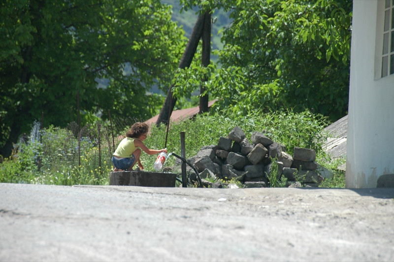 Woman Getting Water - Alkatsikhe, Georgia