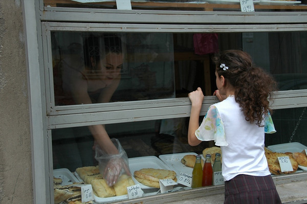 Child Buying Khachapuri - Tbilisi, Georgia