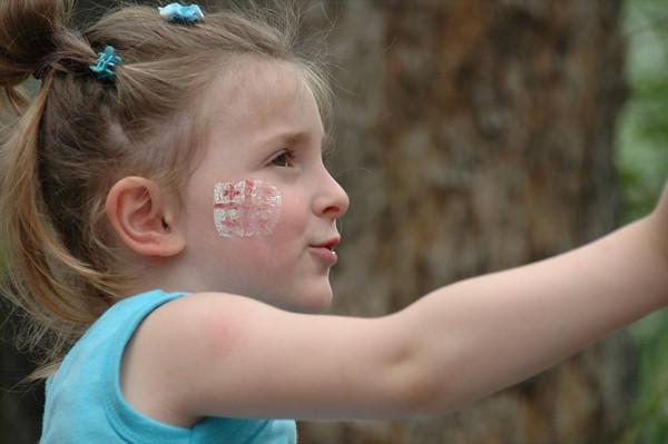 Girl Waving at Parade - Tbilisi, Georgia