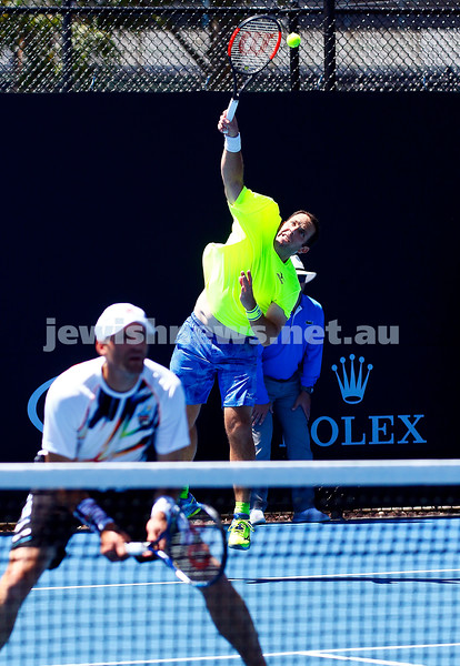 19-1-17. Australian Open 2017. Mens doubles. Scott Lipsky serving with Jonathan Erlich . Photo: Peter Haskin