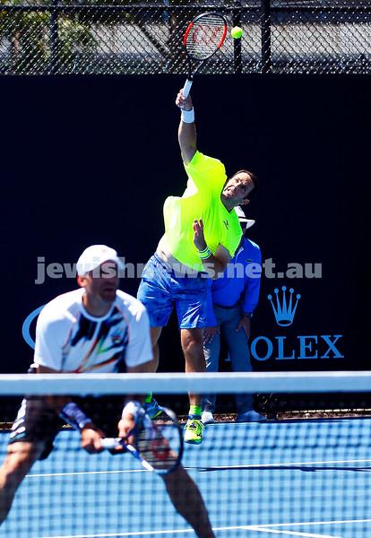 19-1-17. Australian Open 2017. Mens doubles. Scott Lipsky serving with Jonathan Erlich . Photo: Peter Haskin