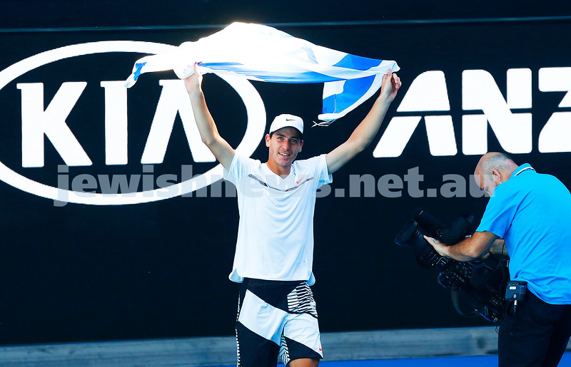 27-1-17. Australian Open 2017. Junior Boys semi final. Yshai Oliel proudly waves the Israeli flag. Photo: Peter Haskin