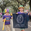 The photo is of Henry (Primer) and Jack (3rd grade) Cavalier along St.Charles Avenue in New Orleans, LA. Natives of New Orleans, each year they travel back to New Orleans to continue their Carnival traditions. Mom (Kelly) is a member of the Krewe of Iris parade organization which is the oldest all women's parade krewe in New Orleans (102 years old), and the largest parading krewe with over 3400 member riders.