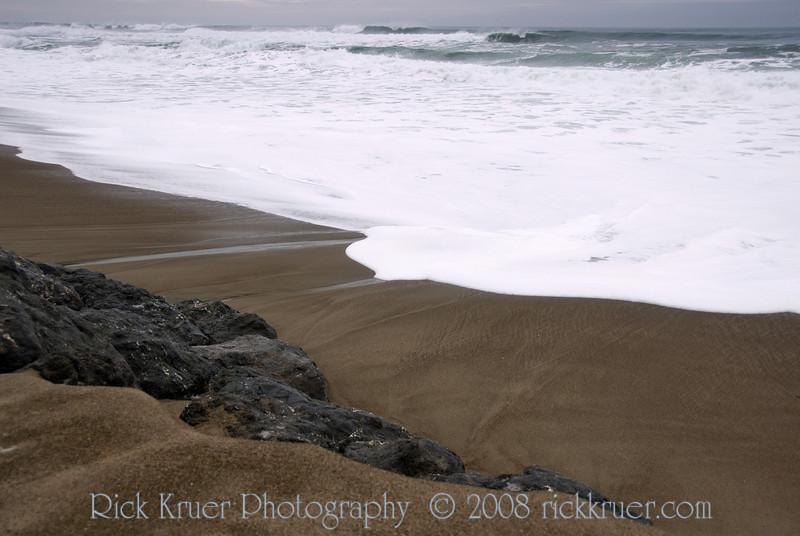 Winter Seafoam Patterns on the Central Oregon Coast<br /> Gleneden Beach, OR<br /> November 2008<br /> <br /> Copyright © 2008 Rick Kruer<br /> rickkruer.com<br /> <br /> D200_20081128_1353_DSC_8305-SeafoamSandPatterns-nice-2.psd