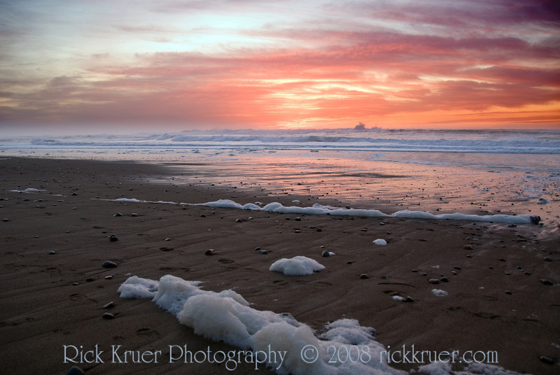 Winter Sunset on the Oregon Coast at the Cavalier Condo<br /> November 2008<br /> <br /> Copyright © 2008 Rick Kruer<br /> rickkruer.com<br /> <br /> D200_20081126_1751_DSC_8129-SunsetSeafoamBlowingWind-nice-2.psd