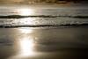 Sunset Reflecting in the Sand<br /> Gleneden Beach, Oregon<br /> July 2007<br /> <br /> Copyright © 2007 Rick Kruer<br /> rickkruer.com<br /> <br /> D200_2007-07-15DSC_1963-SurfLinesSunsetSandReflections-2.psd