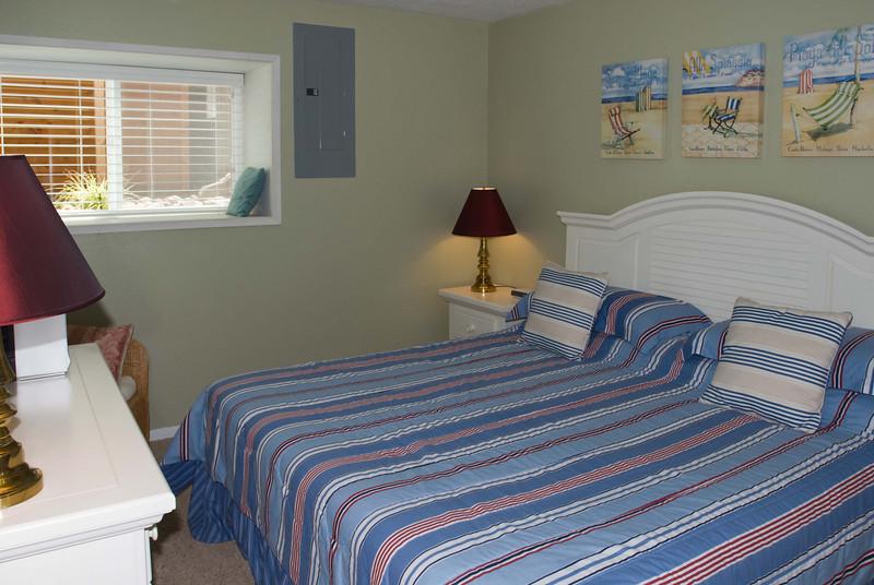 Cavalier Beachfront Condominiums<br /> Unit 27<br /> July 2009<br /> <br /> Copyright © 2009 Rick Kruer<br /> rickkruer.com<br /> cavaliercondos.com<br /> <br /> D200_20090714_1203_DSC_2701-Unit27-GuestBedroom-2.psd