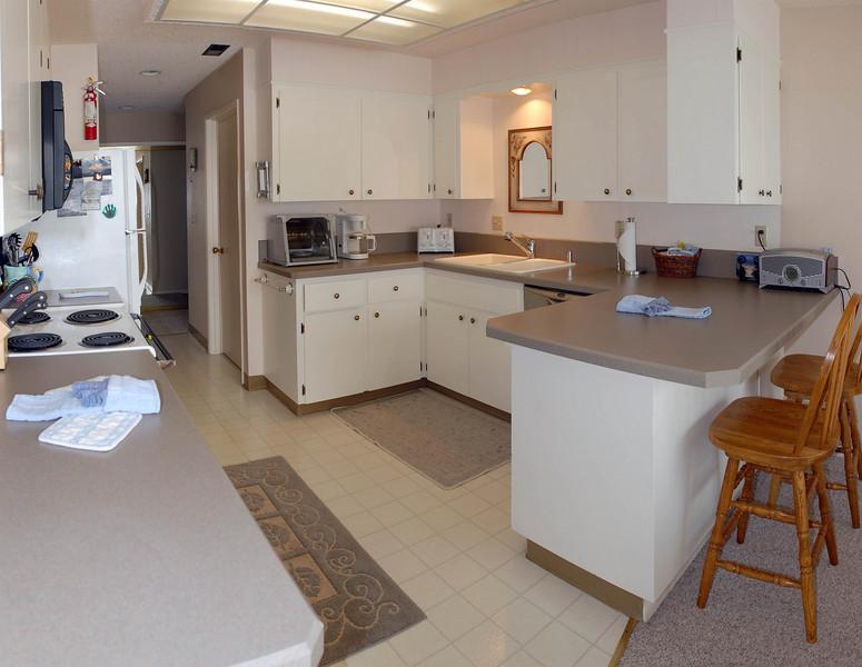 Cavalier Beachfront Condominiums<br /> Unit 33<br /> March 2009<br /> <br /> Copyright © 2009 Rick Kruer<br /> rickkruer.com<br /> cavaliercondos.com<br /> <br /> D200_20090317_1640_DSC_0007-Unit33-DiningRoomView-Pan-0007--0009-3.psd