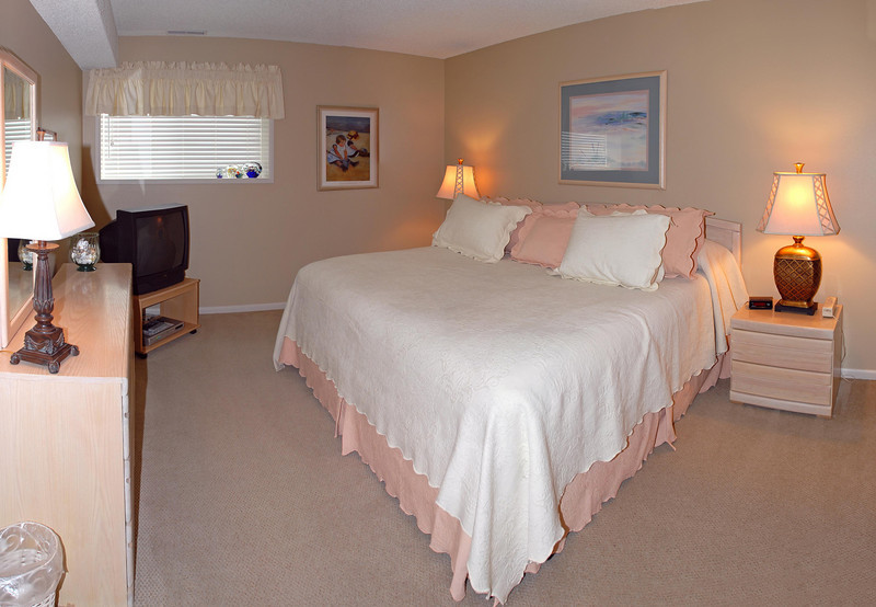 Cavalier Beachfront Condominiums<br /> Unit 38<br /> March 2009<br /> <br /> Copyright © 2009 Rick Kruer<br /> rickkruer.com<br /> cavaliercondos.com<br /> <br /> D200_20090319_1103_DSC_0599-Unit38-MasterBedroom-Pan-0599--0602-3.psd