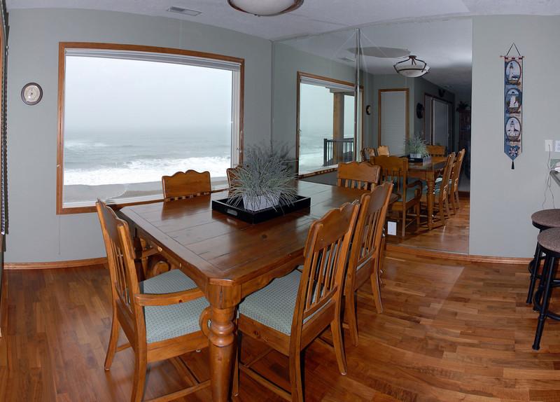 Cavalier Beachfront Condominiums<br /> Unit 40<br /> March 2009<br /> <br /> Copyright © 2009 Rick Kruer<br /> rickkruer.com<br /> cavaliercondos.com<br /> <br /> D200_20090319_1343_DSC_0781-Unit40-DiningRoomview-Pan-0781--0784-3.psd