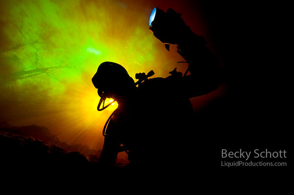 Diver in colorful tannic with light