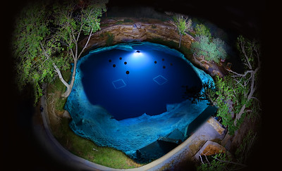 Night light painting of the Santa Rosa Blue Hole.  Over 60 separate images are shot and combined to create this single spectacular image -  Photo by Curt Bowen