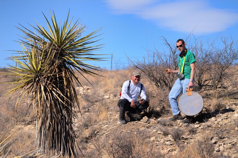 Walter Pickel and Andrew Pitkin use the cave radio locator to pinpoint the actual location of the cave passage.