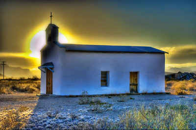 Sunsets behind the little white church