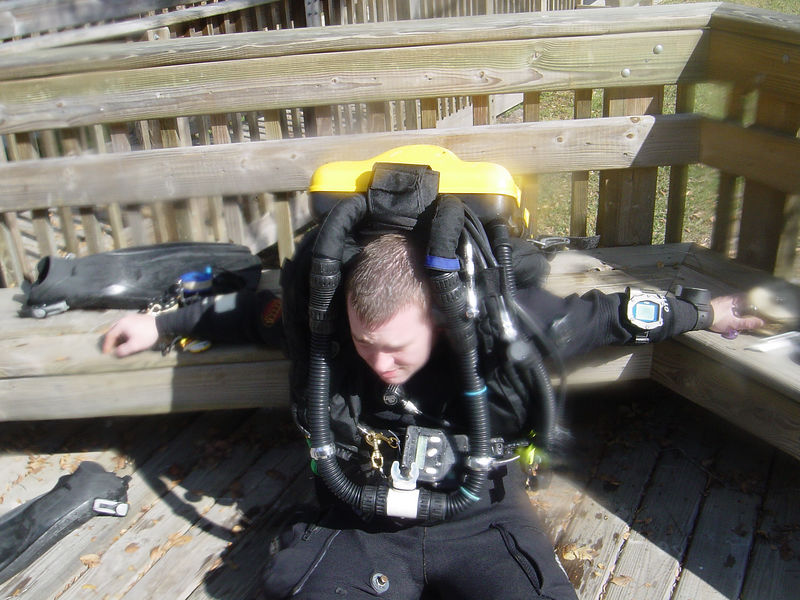 Steve slips off the bench after dive in Little River cave
