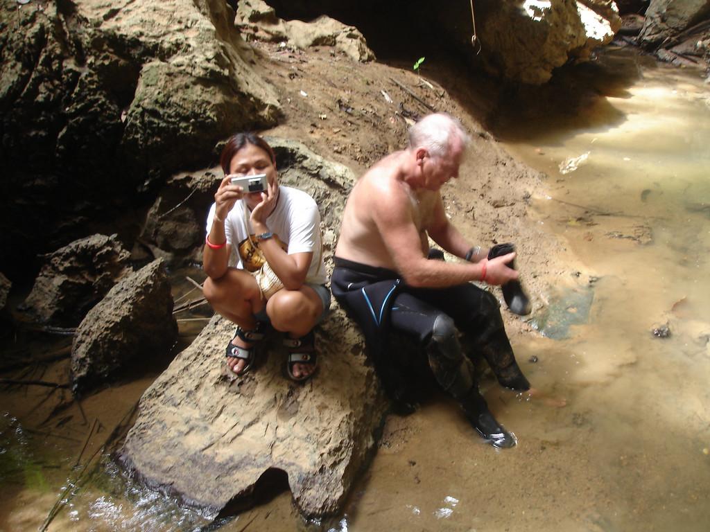 Alex gearing up and Po taking pics at Tham Thong