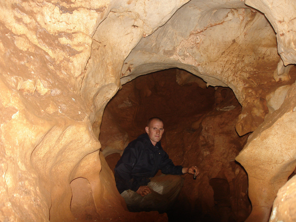 Dave taking a break in dry cave near Sra Keow