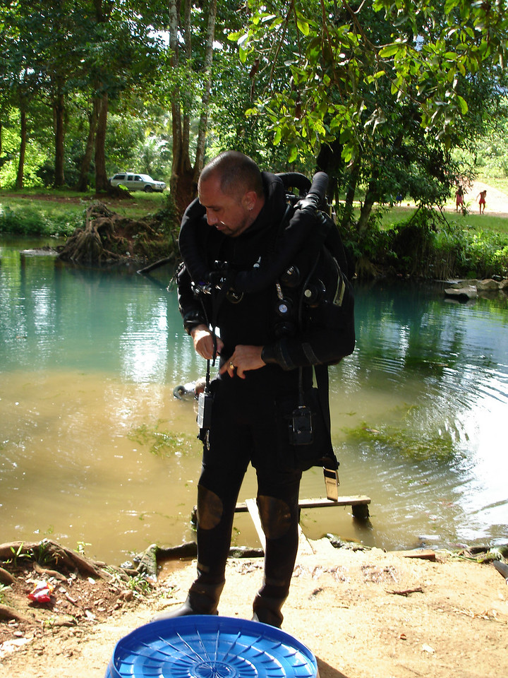 Gearing up for dive to place habitats in cave