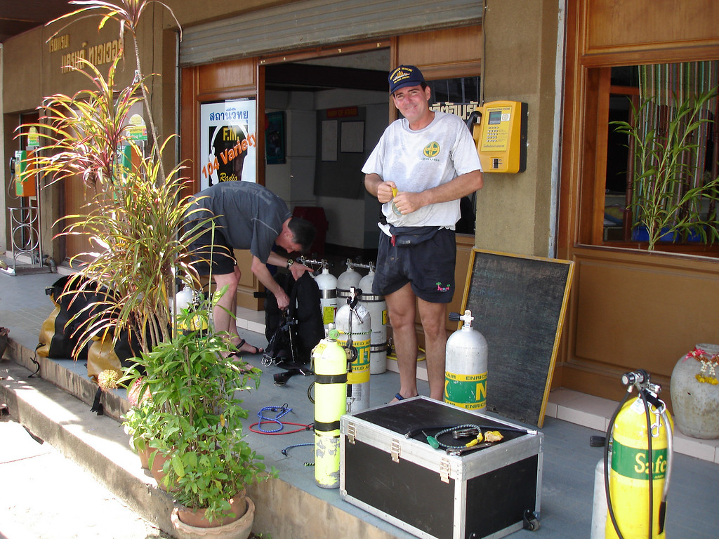 Our handsome young support divers checking their gear infront of the very accomodating (if you will excuse the pun) hotel