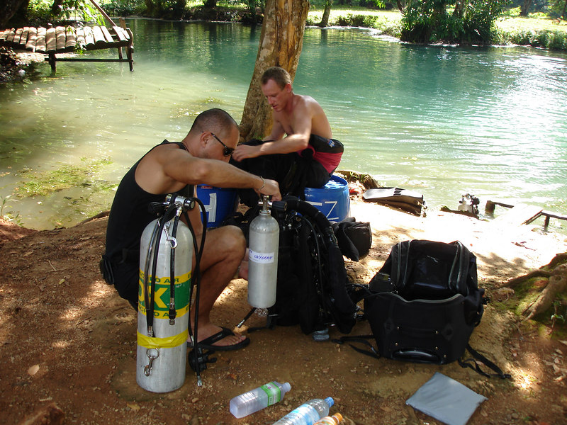 Slow gear up in the 32 degrees C heat<br /> <br /> Gearing up for dive to place habitats in cave