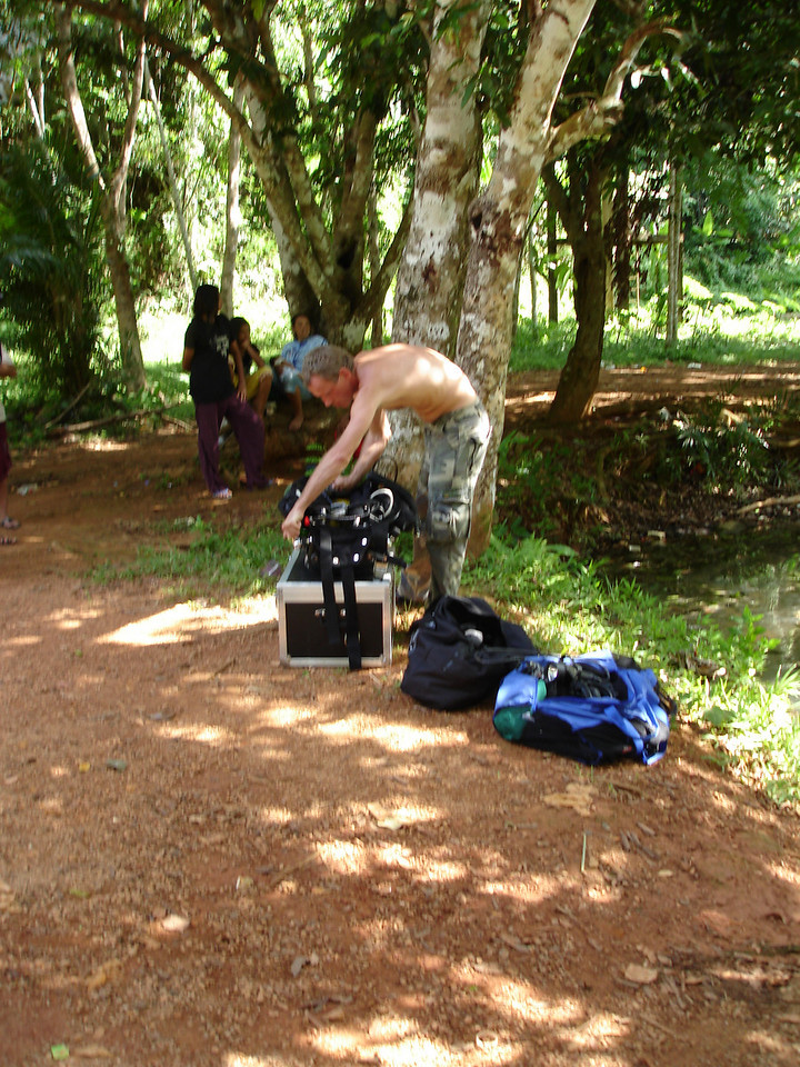 Gearing up for dive to place habitats in cave as locals sit and whatch