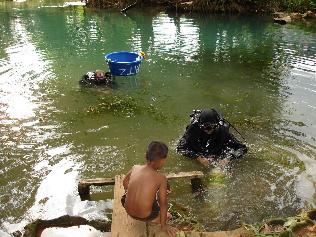 One of the local kids looks on and wonders what we are doing in his bath water