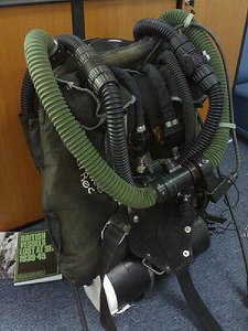 Butt mounted bail out rebreather with rear lungs