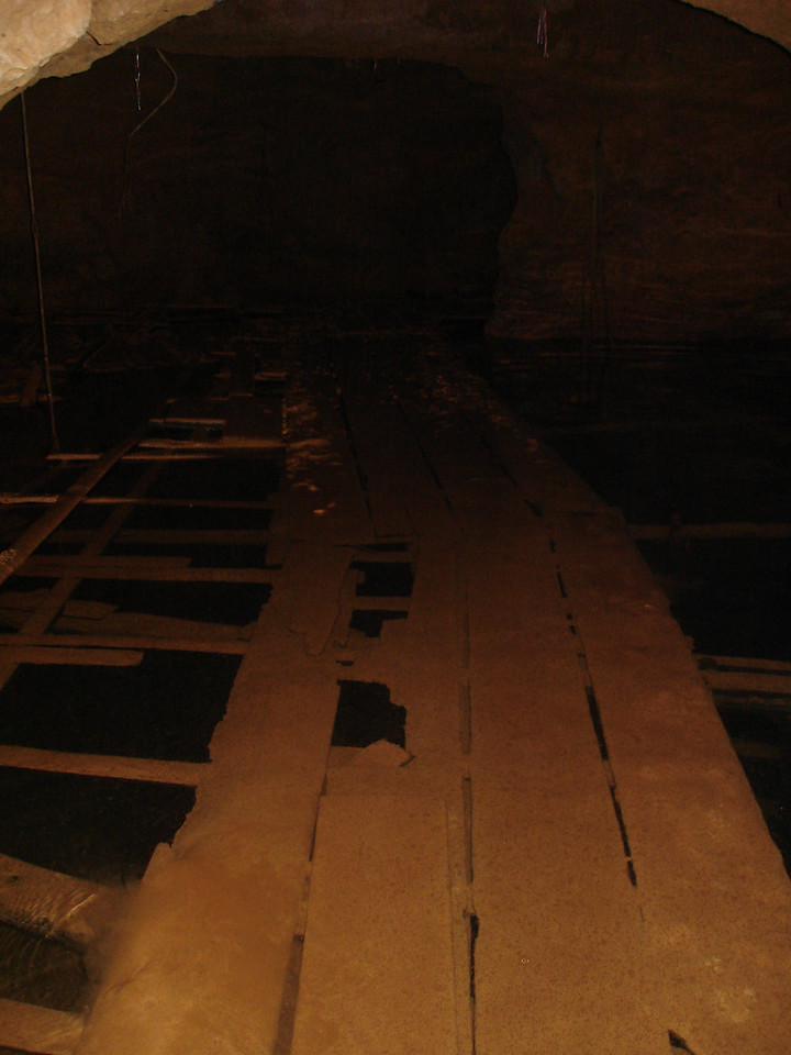 rotten old walkways over water filled passages