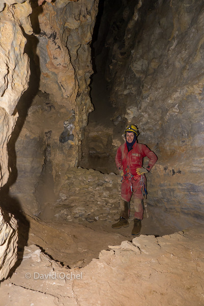 Standing in some sort of miners hearth or basin. Behind the wall, at somewhat lower elevation, is a smaller basin. To collect something filtered from the large one?