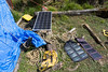 Solar panels charing the 12 V car battery that charges everything else.