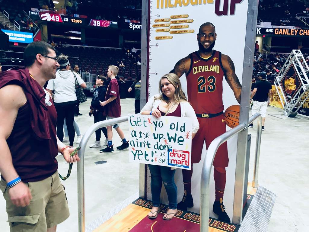 . Megan Matyas of Elyria poses with cut-out of LeBron James as boyfirend Brian Stoll of Amherst prepares to take a photo. David S. Glasier - The News-Herald