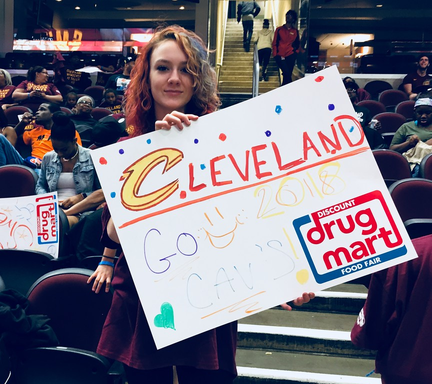 . Destiny Gray of Cleveland holds hand-lettered sign at Cavs Watch Party. David S. Glasier - The News-Herald