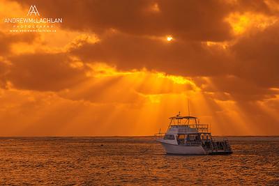 Scuba Dive Boat at sunrise on Cayman Brac, Cayman Islands