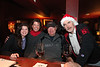 Celebrating at the Black Dog after the Christmas Boat Parade in Cedar Key - Photo by Pat Bonish