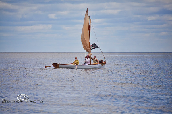 Rowing away with the Booty - Cedar Key Pirate Fest - Photo by Pat Bonish