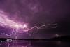 Spider Lightning Behing the Lowkey Hideaway Tiki Bar - Cedar Key Florida - Photo by Pat Bonish