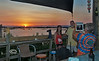 Family photo of the Sunset from the Hideaway Tiki Bar - Low-Key Hideaway, Cedar Key Florida - Photo by Pat Bonish / Bonish Photo