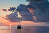 Floating Sunrise - Sailboat sitting on a very calm Gulf Coast just off the Cedar Keys - Photo by Pat Bonish