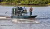 The boys from Cedar Key Seafarms throwing the Cast Net - Cedar Key Florida - Photo by Pat Bonish