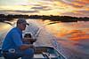 Life Long Cedar Key Resident Heath Davis living life where he knows it best, on the water - Photo by Pat Bonish