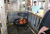 Heath & Freddy getting a good set of coals for the burgers - Hideaway Tiki Bar, Cedar Key Florida