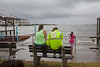 Wendy Slaughter sits on a bench at the Cedar Key Marina as Tropical Storm Andrea makes Landfall - Photo by Pat Bonish