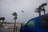 The Red, White and Blue is torn loose from Tidewater Tours Flag Pole and is showing the force of the winds Tropical Storm Debby brought in - Photo by Pat Bonish