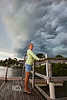 Standing out on the dock watching the Front of Tropical Storm Debby blow into Cedar Key Florida - Photo by Pat Bonish