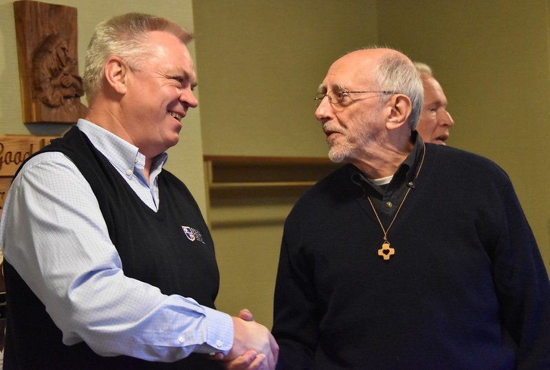 Fr. Ziggy congratulates Fr. Bob